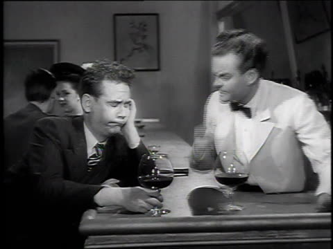 spike jones and another actor at a bar / bartender pours a drink / man drinking and reacting - tonic water stock videos & royalty-free footage