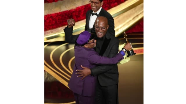 Spike Lee accepts the award for Best Adapted Screenplay for 'BlacKkKlansman' from Samuel L Jackson onstage during the 91st Annual Academy Awards at...
