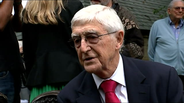 spike milligan statue unveiled in finchley; sir michael parkinson interview sot / parkinson posing beside statue - spike milligan stock videos & royalty-free footage