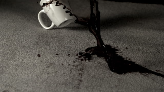 cu slo mo spilled cup of coffee on carpet / burbank, california, usa - macchiato video stock e b–roll