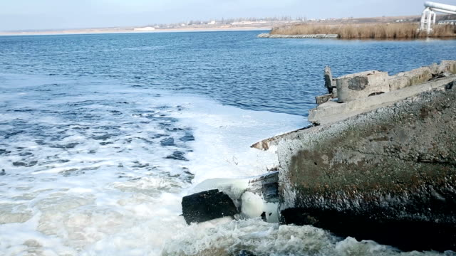 Spillway in winter lake