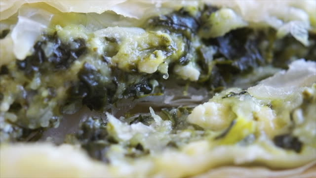 spinach and feta cheese pastry, a look of the filling or stuffing - シェーブルチーズ点の映像素材/bロール