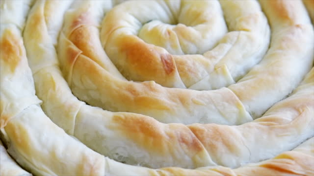 spinach and feta cheese pastry with spiral shape - feta stock videos & royalty-free footage
