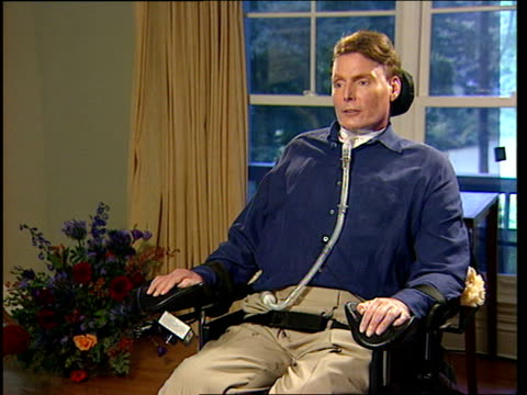 Christopher Reeve interview ITN USA New York ALONG past fields FADE 2 SHOT Slorance Reeve Slorance asking Reeve question Christopher Reeve...