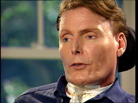 Christopher Reeve interview ITN USA New York EXT Has seen three patients in the d level respond after training Comments on TV advert where walks and...