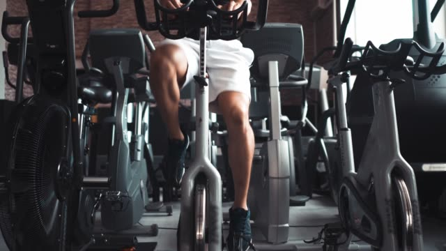 spinn your legs out - exercise machine stock videos & royalty-free footage