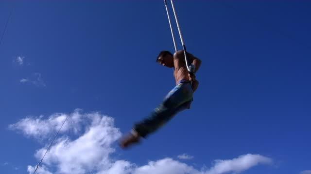 spinning acrobat. - zirkusveranstaltung stock-videos und b-roll-filmmaterial