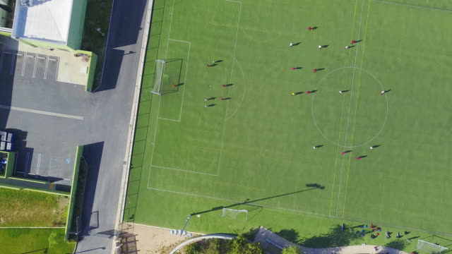 spinning aerial of exciting soccer game - football pitch stock videos & royalty-free footage