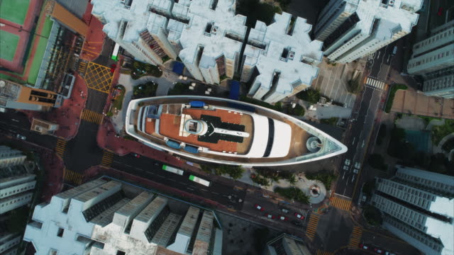 spinning aerial shot above an unusual, ship shaped shopping mall, whampoa garden, hong kong - creativity stock videos & royalty-free footage