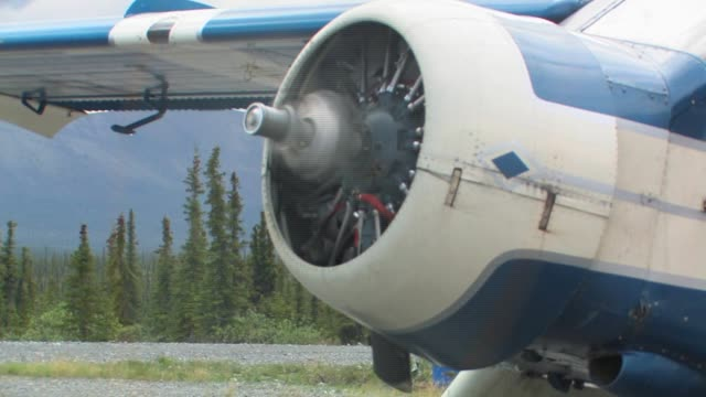 a spinning airplane propeller and wing. - propeller stock videos & royalty-free footage