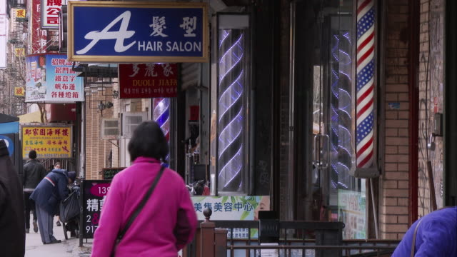 Spinning Barber Shop Sign Along East Broadway in Chinatown