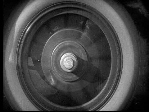 CU, FADE, B&W, Spinning car wheel, hand turning handle on winch