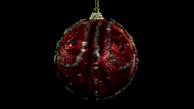 spinning christmas ball - ornament stock videos and b-roll footage