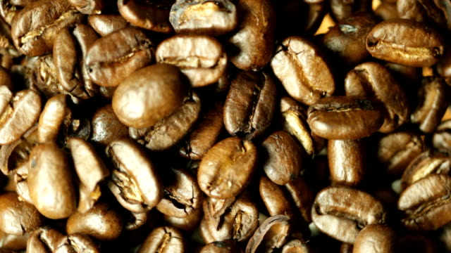 spinning coffee beans. hd - espresso stock videos & royalty-free footage
