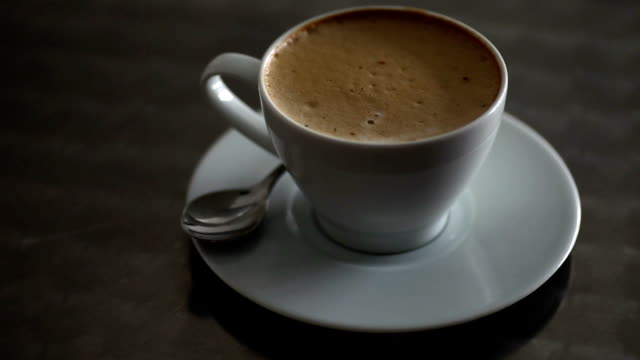 spinning coffee... - froth art stock videos and b-roll footage