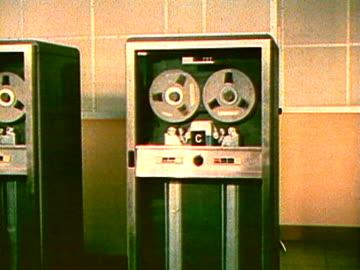 spinning computer reels - archivmaterial stock-videos und b-roll-filmmaterial