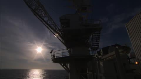 cu, la, spinning crane, ocean and sun in background, nova scotia, canada - crane construction machinery stock videos & royalty-free footage