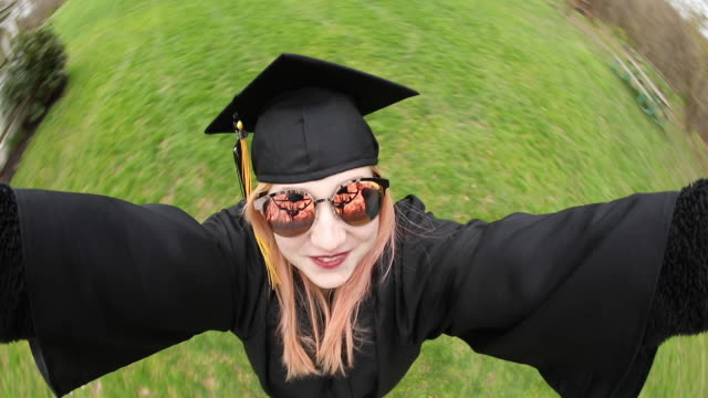 spinning fisheye selfie graduate - graduation stock videos & royalty-free footage