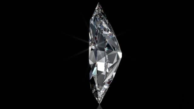 spinning marquise cut diamond with sparkles - stone object stock videos and b-roll footage
