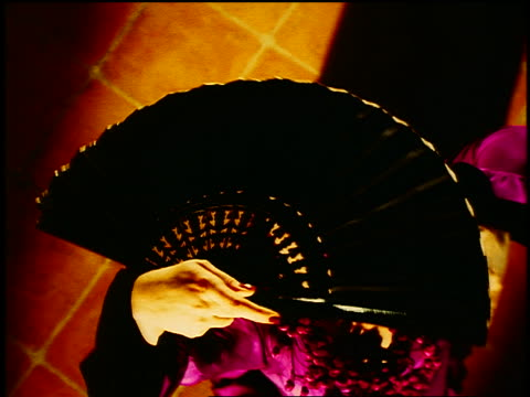 spinning overhead hispanic woman in native dress with fan flamenco dancing on tile floor - flamenco dancing stock videos and b-roll footage
