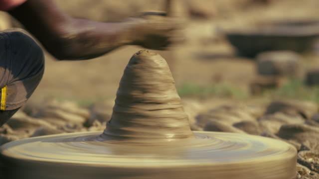 spinning pottery wheel with clay / kannauj, uttar pradesh, india - porcelain stock videos & royalty-free footage