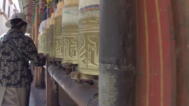 Spinning prayer wheels in Lhasa, Tibet
