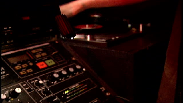 spinning records and sound board in dj booth in london - record player stock videos & royalty-free footage