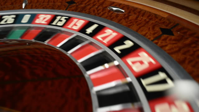 spinning roulette wheel close-up - roulette stock videos and b-roll footage