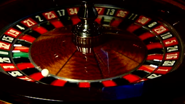 spinning roulette wheel - roulette wheel stock videos and b-roll footage