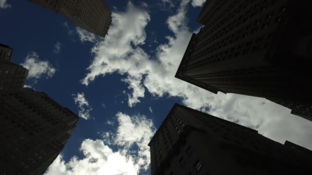 Spinning shot of clouds and buildings at Wall Street, New York