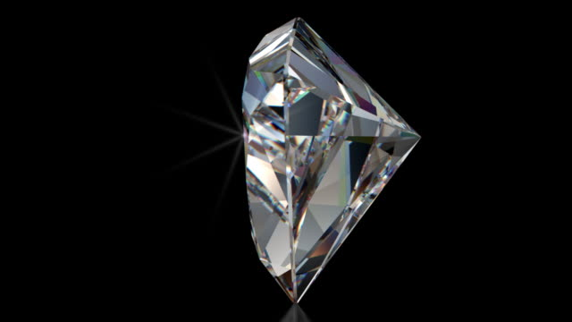 spinning trillion cut diamond with sparkles - prism stock videos & royalty-free footage