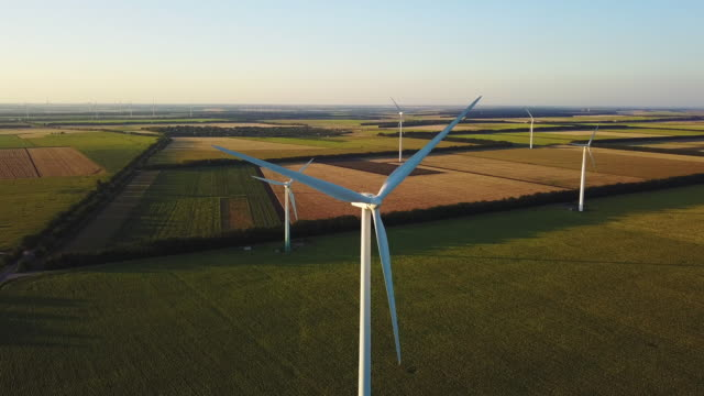Spinning wind turbines in farm fields