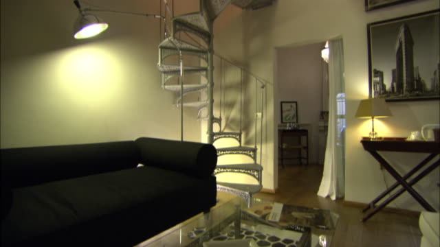a spiral staircase highlights a fancy room in a hotel. - spiral staircase stock videos & royalty-free footage