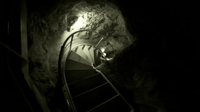 spiral staircase to the dungeon - spiral staircase stock videos & royalty-free footage