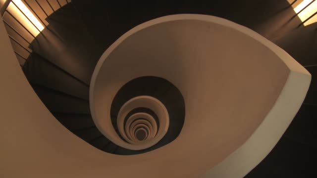 a spiral staircase transcends the levels of the gran hotel domine bilbao in spain. - spiral stock videos and b-roll footage