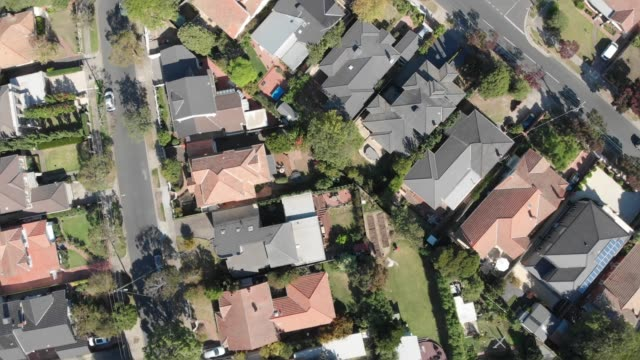 4k spiralling aerial topdown view of houses in the suburbs of melbourne - city life stock videos & royalty-free footage