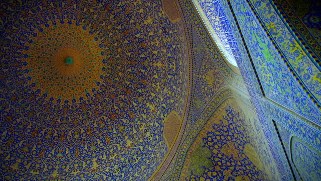 spiralling shot to domed ceiling of shah mosque, isfahan - mosque stock videos & royalty-free footage