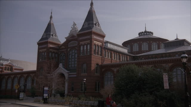 la spires and entrance of the arts and industries building, smith castle / washington, d.c., united states - smithsonian institution stock videos & royalty-free footage