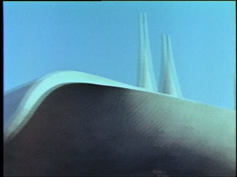 pan of spires curved building at ny world's fair - weltausstellung in new york stock-videos und b-roll-filmmaterial