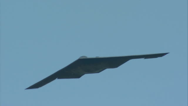 b-2 spirit flying in the sky - bomber plane stock videos and b-roll footage