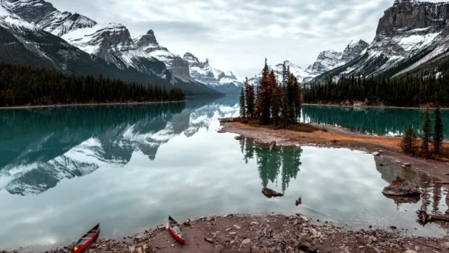 spirit island with canadian rockies and red canoe on maligne lake at jasper national park - maligne river stock videos & royalty-free footage
