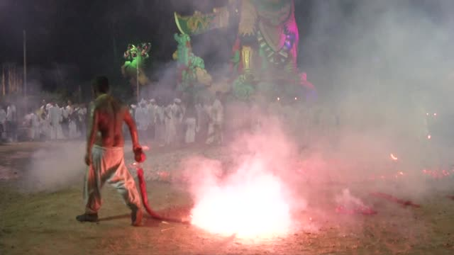 spirit mediums light firecrackers before firewalking at the phuket vegetarian festival in phuket town thailand the event is held over a nineday... - phuket stock videos & royalty-free footage