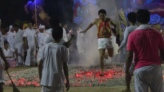 Spirit mediums walk on burning coals at the Phuket Vegetarian Festival in Phuket Town Thailand The event is held over a nineday period in October...