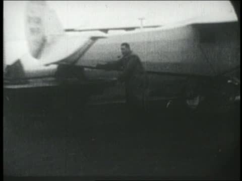 spirit of st. louis airplane being pushed onto airfield in ny - anno 1927 video stock e b–roll