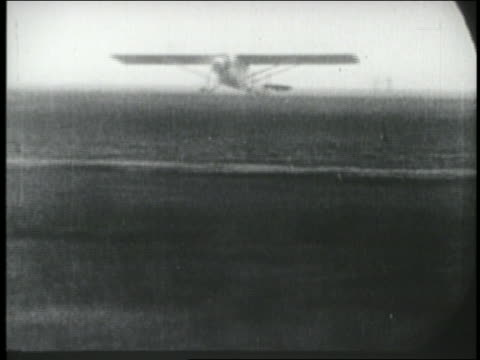 stockvideo's en b-roll-footage met spirit of st louis airplane bouncing before finally lifting off ground / ny - 1927