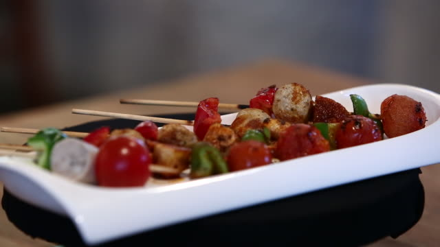spit roasted sausage and tomato dish seasoned with grated brown mealworm - grated stock videos & royalty-free footage