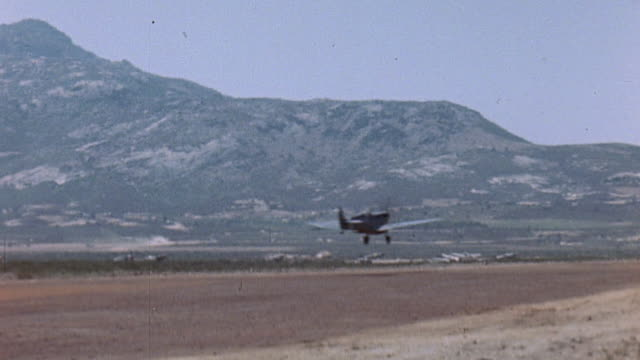 Spitfire fighters taking off from Alto Airbase and control tower with windsock / Corsica France