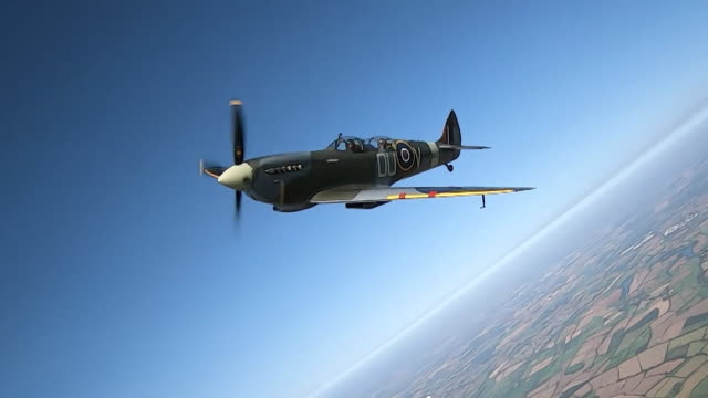 spitfire flying over northamptonshire against bright blue sky on 80th anniversary of world war two battle of britain - mid air stock videos & royalty-free footage