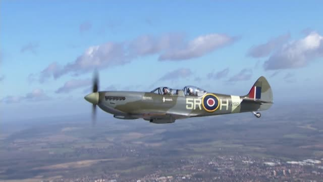spitfire takes to the air to mark 80th anniversary of plane's first flight england hampshire southampton ext air to air shot spitfire aircraft in... - air to air shot stock videos and b-roll footage