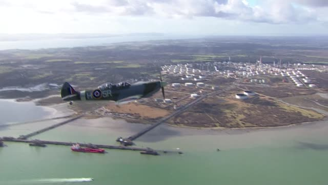 spitfire takes to the air to mark 80th anniversary of plane's first flight **jones interview overlaid sot** air to air shot spitfire plane in flight... - air to air shot stock videos and b-roll footage